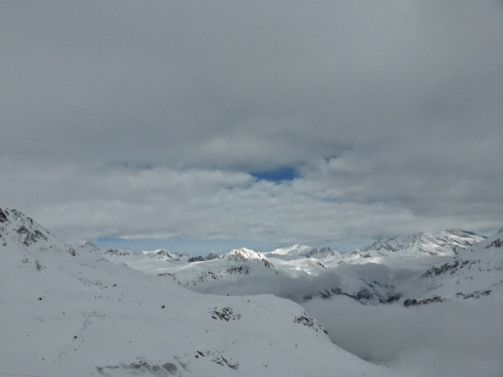 Vallon de l'Iseran, layers of clouds linger after the previous day's snowfalls
