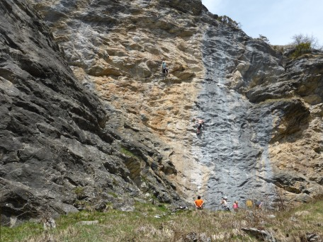 A few rock climbers on the cliff left of the path