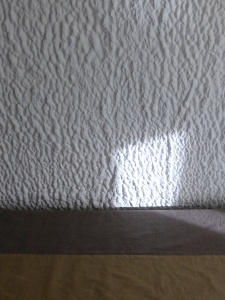 Light on the wall and bed