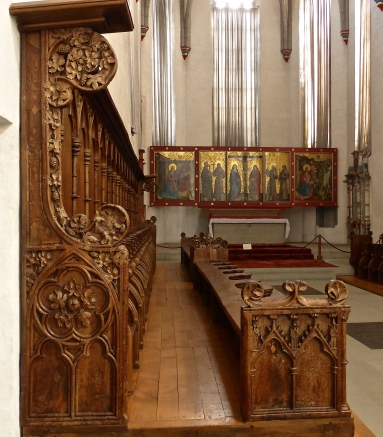 Fribourg, Cordeliers convent: elaborately carved pews and c.14th altar piece